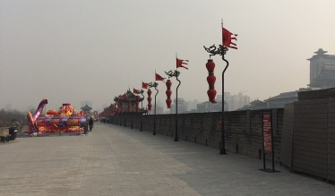 xi'an city wall with flags